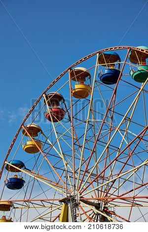 Ferris Wheel On The Background Of Blue Sky