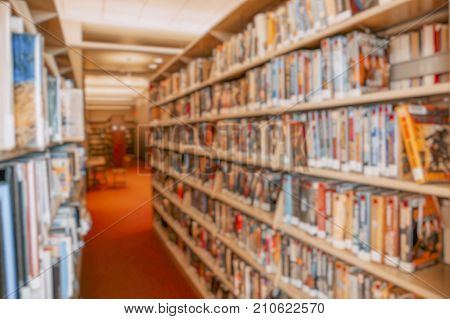 blurred background of library. Books in public library