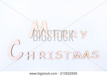 Merry Christmas Holiday Greetings Card on white board table.