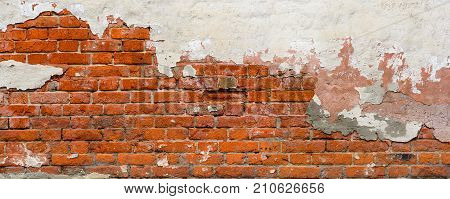 Old Brick wall panoramic view. Red brick wall with damaged plaster background.