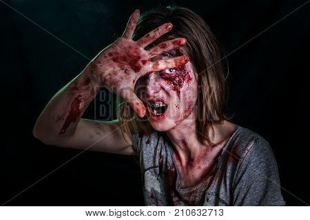 Close-up portrait of horrible zombie woman with wounds. Horror. Halloween poster.The shouting female zombie