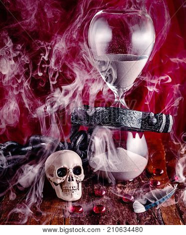 Time is like smoke in the wind light as a feather and fleeting. Yet we are chained to it as the sand falls through the hour glass until death takes us.