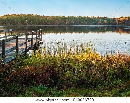 An early Autumn scene of Prospertown Lake in Jackson New Jersey.