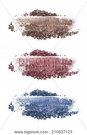 Set of eyeshadow sample isolated on white background. Crushed brown, blue and marsala metallic eyeshadow. Closeup of a makeup product.