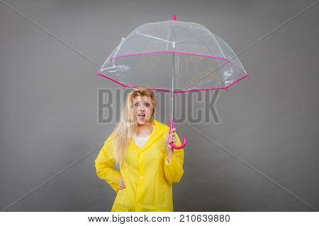 Woman Holding Transparent Umbrella Looking Shocked