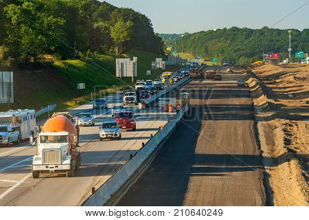 BEDFORD HEIGHTS OH - JUNE 28 2017: Traffic is diverted to the outer edges of Interstate 271 as work gets underway adding new lanes.