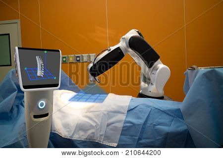 the robot assistant in medical technology use for scan a patient before spinal surgery and send the data of 3d spinal to the monitor on robot it help to pinpoint instrument accuracy for quicker safer