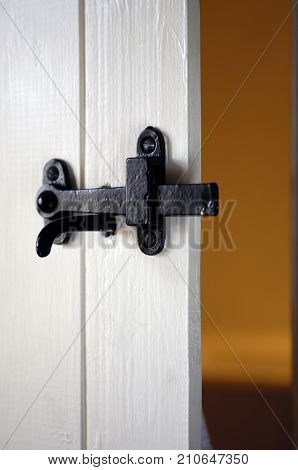 Black Iron Latch On White Wooden Door