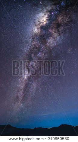 Landscape with Milky way galaxy over mountain. Night sky with stars. Long exposure photograph.