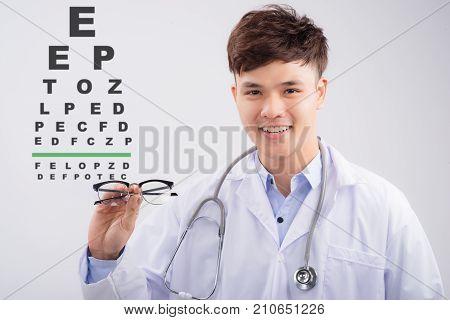 Asian Male Oculist Doing An Eyesight Test With Eye Chart