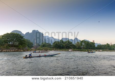 Vang Vieng, Laos - November 2015: Boat Service For Tourists In Nam Song River, Vang Vieng, Lao Pdr.