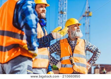 Builders Discussing Work