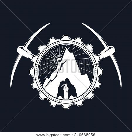 Miner is Holding Pickaxe in the Bowels of the Mountain on a Background of the Sunburst in a Gear with Two Crossed Pickaxes, Vintage Emblem of the Mining Industry, Vector Illustration