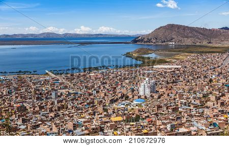 Peruvian City Puno And Lake Titicaca Panorama, Peru