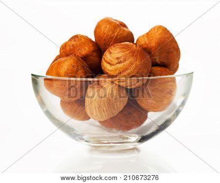 hazelnut in the bowl isolated on white background