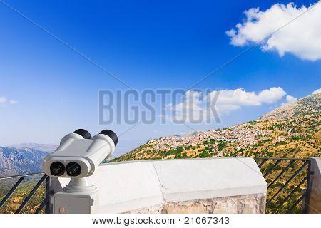 Binoculars And Arachova On Mountain Parnassos, Greece
