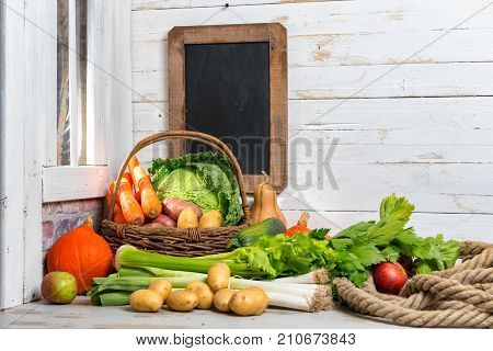 raw vegetables to cooking french pot-au-feu with chalkboard