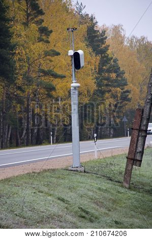 Traffic enforcement camera speed control radar camera at countryside road highway Latvia