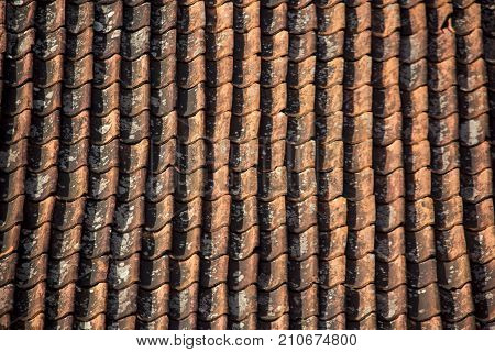 Antic Tile texture on the roof of an old kuldiga house in Latvia. Architecture background