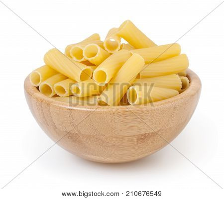 Rigatoni pasta in wooden bowl isolated on white background with clipping path