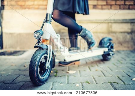 Close Up Details Of Modern Transportation, Electric Kick Scooter, Portrait Of Girl Riding The City T