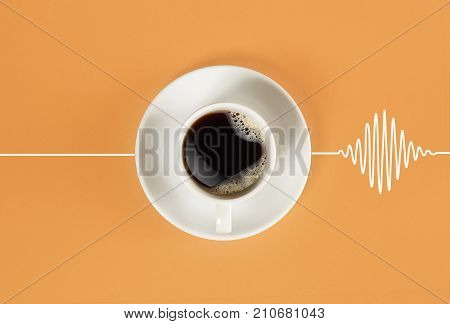 Invigorating coffee in the morning awakens the head and causes the heart to beat. Top view on orange background. Still life. Mock up. Flat lay
