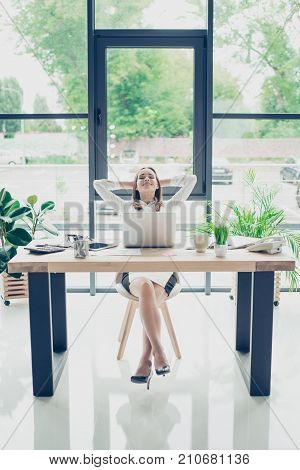 Successful Relaxed Lawyer Is Resting At Her Work Station And Dreams Of Holiday Which Is Coming, With