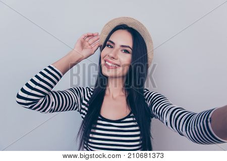 Portrait Of Young Carefree Gorgeous Traveller, Grinning, In Beige Head Wear, On Grey Background, In