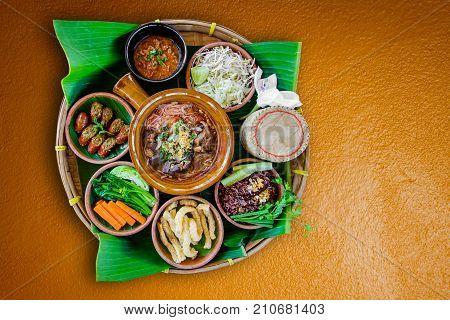 Tradition Northern Thai food. Thai cuisine chili sauce Thai sausages deep fried pork skin Steamed whole grain traditional. Thai food concept