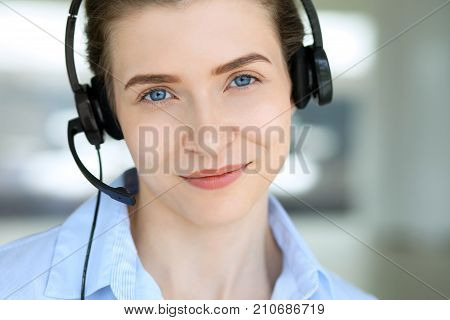 Call center operator. Portrait of beautiful business woman in headset.