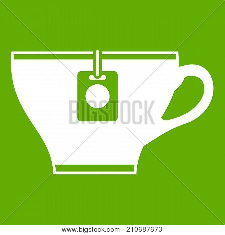 Cup with teabag icon white isolated on green background. Vector illustration
