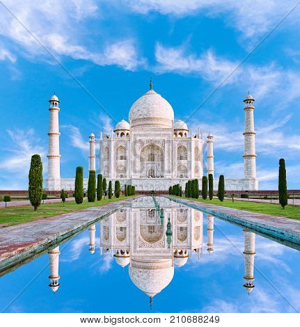 Amazing view on the Taj Mahal in sun light with reflection in water. The Taj Mahal is an ivory-white marble mausoleum on the south bank of the Yamuna river. Agra Uttar Pradesh India.