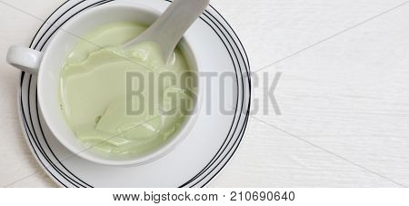 Drink background Tofu green tea ceramic white cup and plate kitchen ware set top view close up Isolate on wood white texture and copy space.