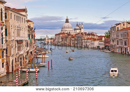 View from the Academy Bridge to the Grand Canal, Palazzo and the Cathedral of Santa Maria della Salute. Venice. Italy