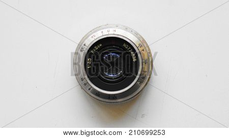 This is the lens from the old Soviet mirror photo camera of the 70s of the Zenith family that I used in those years.