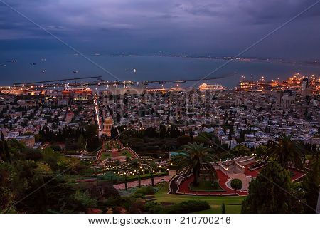 Bahai gardens and Shrine of the Bab on the slopes of the Carmel Mountain and view of the Mediterranean Sea and bay of Haifa city by night, Israel