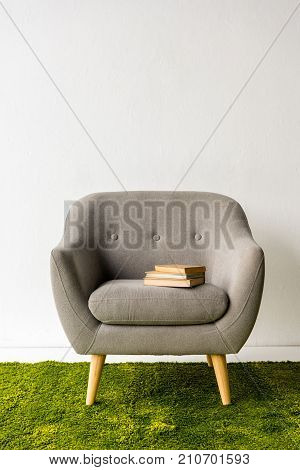Books On Gray Armchair