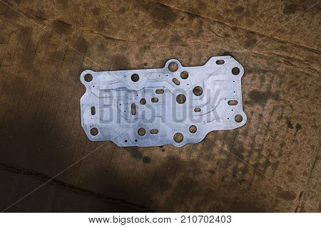 Steel gasket interior of Transmission linear shift solenoid. transmission parts controller of car engine. Automotive parts concept.