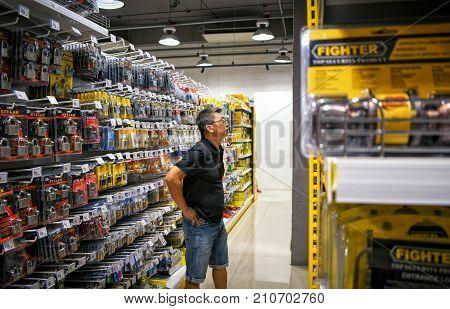 BANGKOK THAILAND - OCTOBER 22: Customer shops for locks in the aisle in Mr. DIY hardware store located in Victoria Garden in Bangkok on October 22 2017