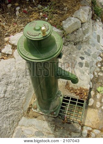 Green Iron Water Pump In A French Village