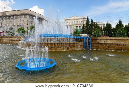 Novosibirsk Russia - June 30 2017: Fountain in Pervomaysky Square. Novosibirsk is the administrative center of Siberian Federal Distric