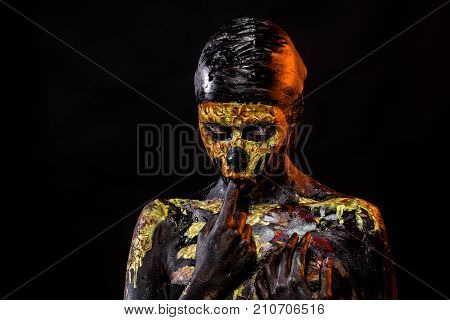 Halloween woman skeleton suck finger. Body painting and art. Girl with skull face paint on black background. Day of dead celebration. Life and death concept.