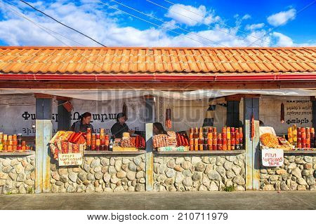 GARNI, ARMENIA - OCTOBER 1, 2016: Local people sell armenian home made jams and traditional sweets made from dried fruits at the market near the ancient temple of Garni, Armenia.