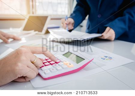 Business strategy invesment consept : Two businessman confident executive colleagues meeting and discussing at office. Business plan brainstorming meeting for financial team.