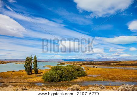 Patagonian Pampas. Flat plain with shallow lakes and yellowed grass. Concept of active and exotic tourism