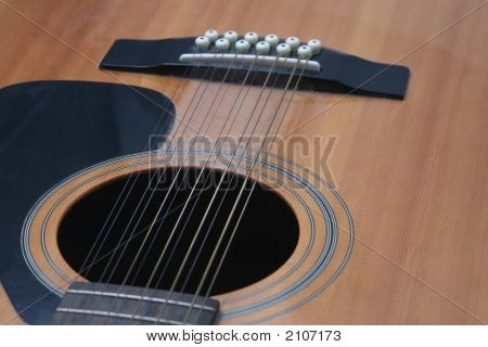 Guitar Closeup Of Soundhole And Bridge Looking Down