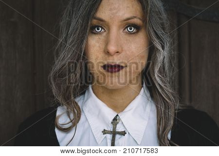 Zombie woman looking at camera with creepy eyes