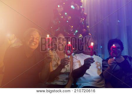 Family on the living room celebrating 2018