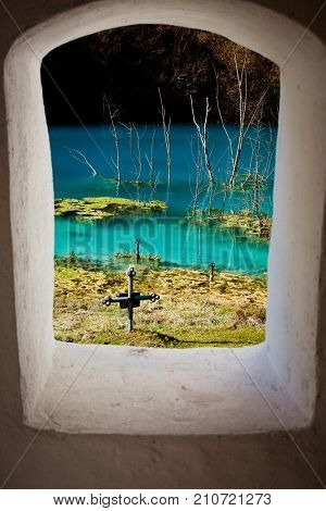 church with its cemetery under contaminated water in Geamana, Romania. Polluted lake with mining residuals that destroyed a village.