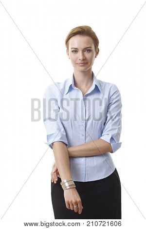 Portrait of smiling attractive businesswoman, looking at camera.